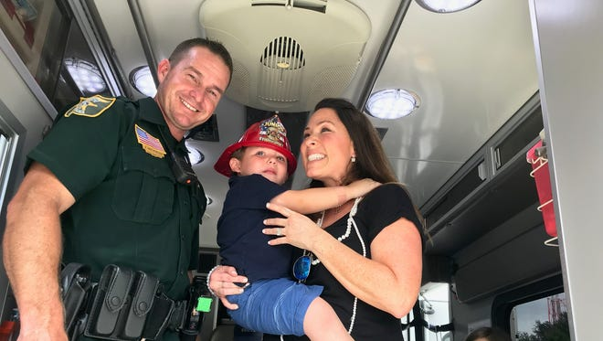 Deputy Hickman, with Dominic and his mother, Karla Mancini, on the day they reunited. Three years ago, Hickman helped Dominic get to a local hospital fast enough to survive.