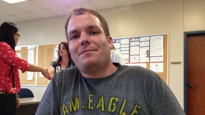 Alex Beebe, 25, was seriously injured in March when he lost control of his pickup truck and crashed. Beebe, who still is in a wheelchair, credits his survival to wearing his seat belt.