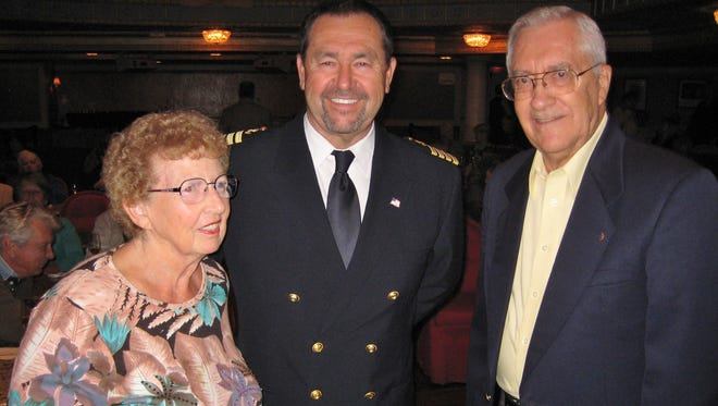 Bob and Dianne Herschelman are pictured with Captain Brent Willits, master of the American Queen, during the farewell reception.