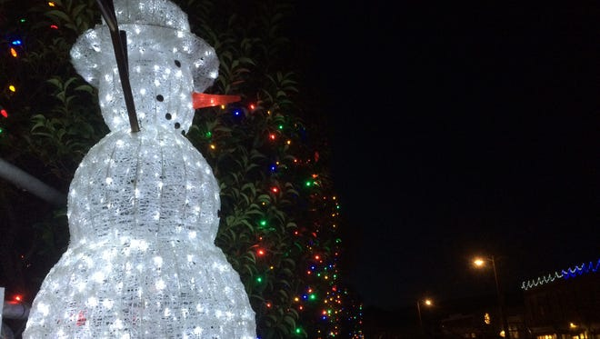 A lighted snowman stands guard over Upper Park in Jerome, Ariz., on Nov. 29, 2014.