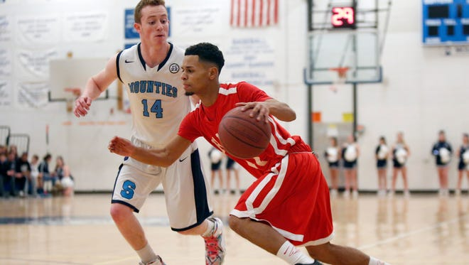 North Rockland's Michael Arias (11) dribbles against Suffern's Kevin Jefferson (14) during a boys basketball game against Suffern at Suffern High School on Thursday, Jan. 14, 2016.  North Rockland took the win 56-49.
