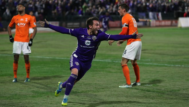 Louisville City FC's Cameron Lancaster celebrates with his team after scoring their only goal on a header.