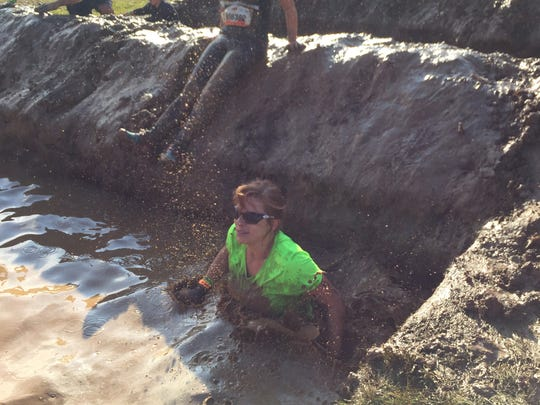 Stephanie Nottling (green) did the 10-mile Tough Mudder Wisconsin.