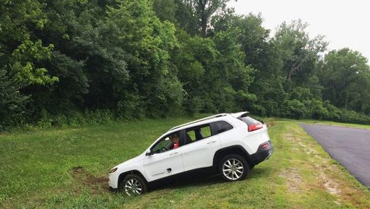 """A Jeep Cherokee winds up in a dtich after hackers working with """"Wired"""" magazine successfully took control of the vehicle by hacking in through its connected-car inffotainment system. The article puts a renewed spotlight on the technological vulnerability of the coming fleet of connected automobiles"""