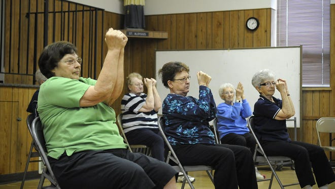 People take part in a senior exercise class May 6 in St. Stephen.