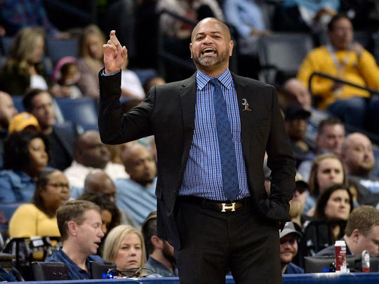 Memphis Grizzlies interim head coach J.B. Bickerstaff calls to players in the first half of an NBA basketball game against the Philadelphia 76ers Monday, Jan. 22, 2018, in Memphis, Tenn. (AP Photo/Brandon Dill)