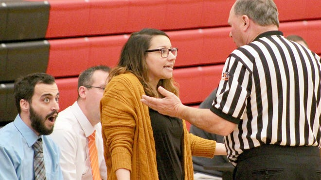 Kewanee coach Jessica Shipley discusses a call with the game official while varsity assistant Nick Christakos listens in amazement.
