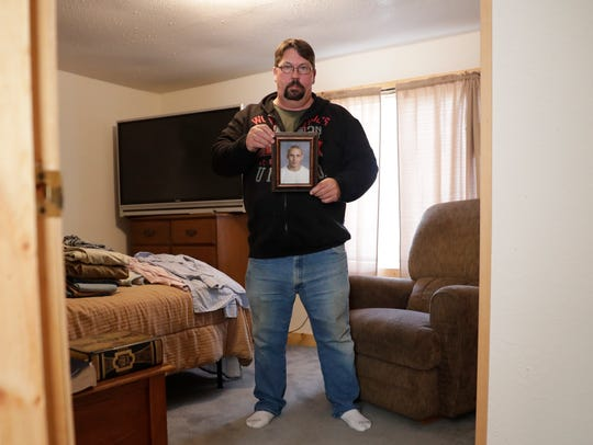 Terry Riebe stands in the bedroom he kept for his son,