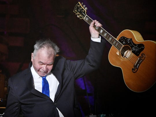 John Prine finishes his performance during the Americana