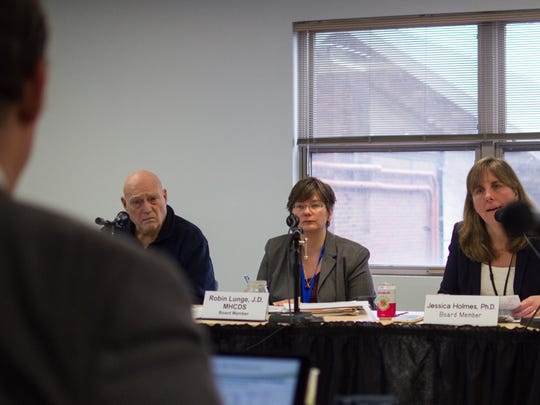 Members of the Green Mountain Care Board Con Hogan, from left, Robin Lunge and Jessica Holmes listen as the University of Vermont Health Network reports exceeding its budget on April 4, 2017 in Montpelier.