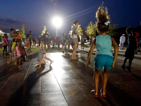 Kids dance at a past Dancing in the Park and Food Truck