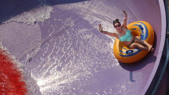 Kayla Kyle spins around 'Tornado Alley' at Wild Water West on Sunday, June 28, 2015.