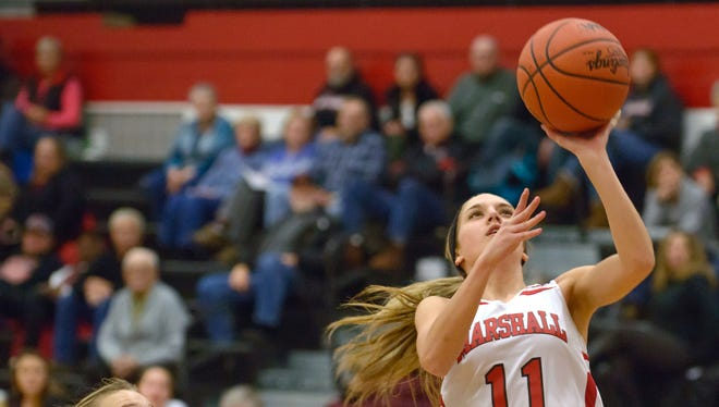 Marshall's Taryn Long (11) goes for a layup against Holt on Tuesday.