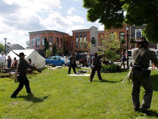 Confederate soldier reenactors practice drills Sunday