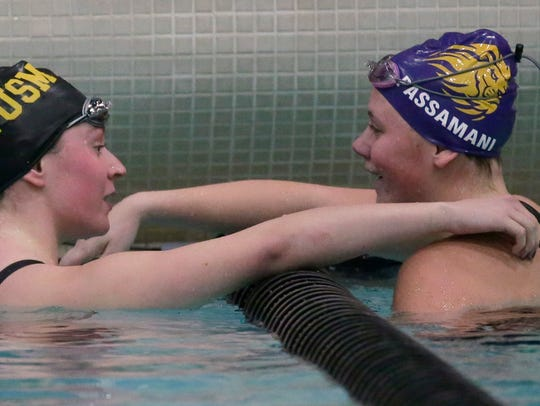 New Berlin Eisenhower's Bella Passamani is congratulated by Brown Deer/University School's Katie Hayes after she won the 100-yard butterfly at the WIAA Division 2 girls state meet at the University of Wisconsin Natatorium in Madison.
