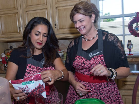 Paulette Guajardo and Laureen Pedrotti prepare food