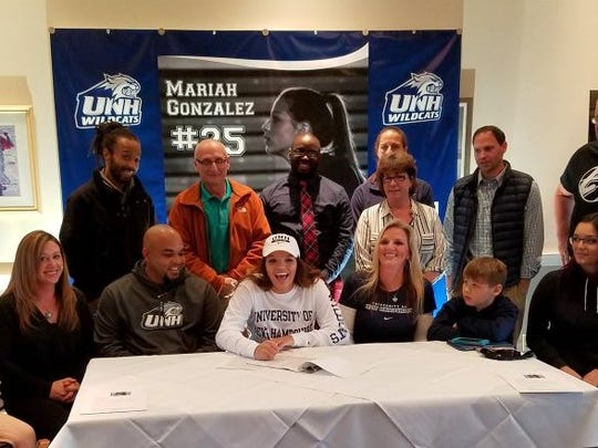 Mariah Gonzalez signs her National Letter of Intent to play basketball at New Hampshire on Wednesday at Seneca Harbor Station.