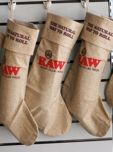 Christmas stockings made from hemp are among many small gift items available at Rolling Papers NM in downtown Deming.