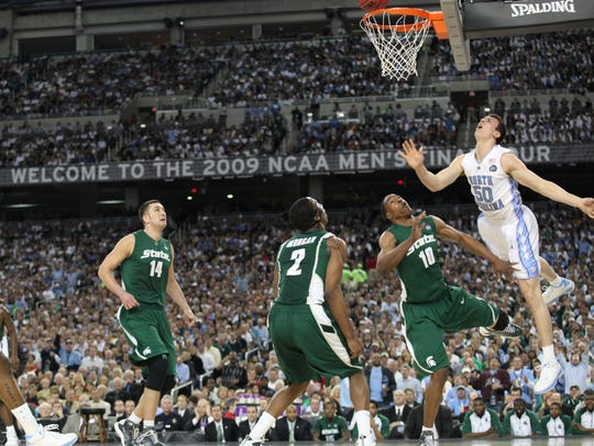 Michigan State's Goran Suton, Raymar Morgan and Delvon Roe watch North Carolina's Tyler Hansbrough's shot hang on the rim.