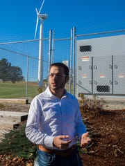 Chip Palombini, sales manager for the Energy Storage Group at Dynapower Corporation, explains how the company uses a combination of renewable and battery-stored energy at the company's headquarters in South Burlington on Monday, November 7, 2016.