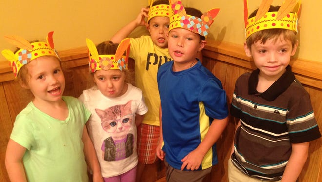 Kent House campers made feather headbands and learned about Native American culture Monday. From left to right are campers Gianna Hines, Rosaley McCroskey, Hunter DeKeyzer, Jackson Vetts and Lenny Logan.