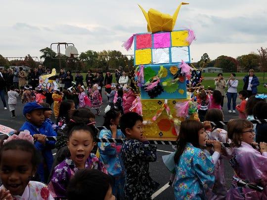 Students parade around the grounds of Livonia's Niji-Iro