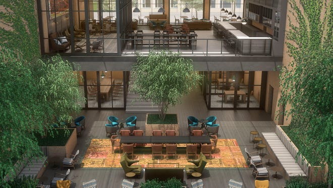A rendering of the lobby at a Canopy by Hilton hotel.