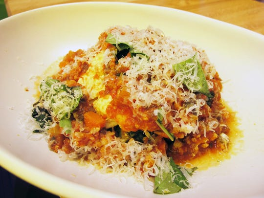 Lasagna Bolognese, a gluten-free dish made with house-made chicken sausage, mushrooms, spinach, lemon ricotta and herbs, at True Food Kitchen in Naples' Waterside Shops.