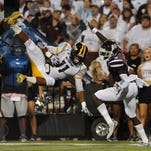 Southern Miss senior Kalan Reed hauls in an interception against Mississippi State last season.