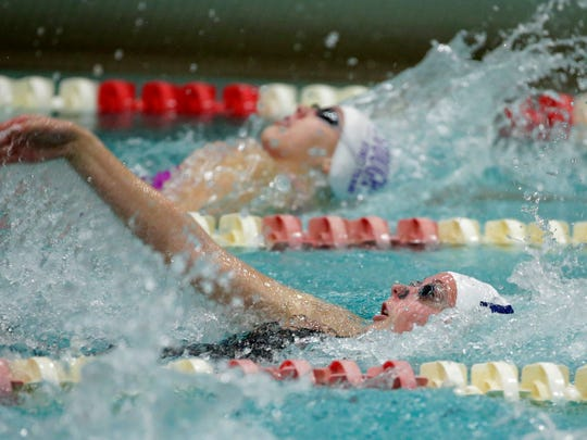 Whitnall's Kelly McElvain swims the 100-meter backstroke.