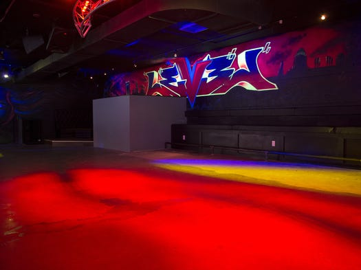 Take a look inside Level Nightlife, the new night spot above Downtown bar Vyrsd. Neon, glow-in-the-dark graffiti covers the walls.