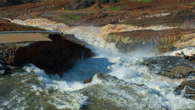 This shows the water from the Oroville Dam Auxiliary Spillway at Lake Oroville as it continues to flow eroding the roadway just below the spillway that leads to the spillway boat ramp in Butte County, Calif., on  Feb. 12, 2017.