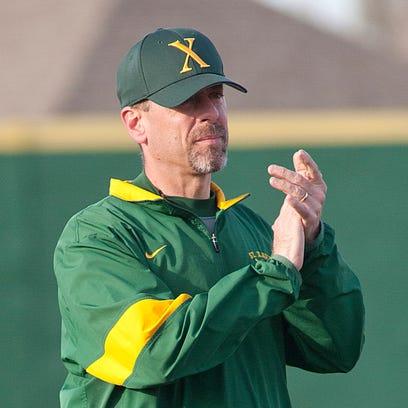 St. Xavier Tigers head baseball coach Andy Porta encourages