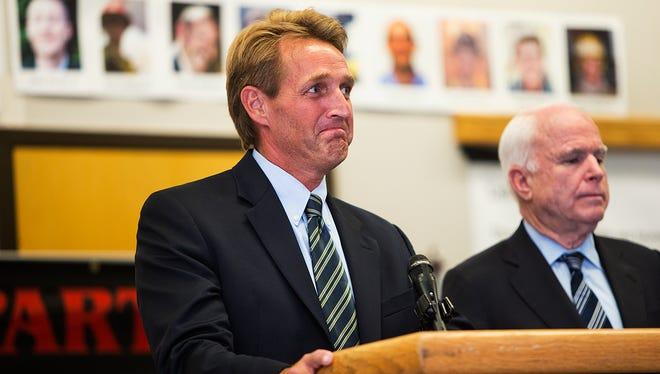 Sens. Jeff Flake and John McCain, both Arizona Republicans, in a 2013 photo.