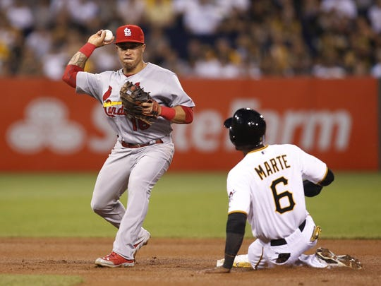 St. Louis Cardinals second baseman Kolten Wong throws to first base after forcing Pittsburgh Pirates left fielder Starling Marte out at second base in a game against the Pittsburgh Pirates.