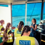 Middle School students enrolled in the Guam Community College's National Summer Transportation Institute toured the Federal Aviation Administration Air Traffic Control Tower on June 24.  Lynn Mattix, air traffic manager, explains how air traffic controllers guide planes on takeoff, landing and while they are in Guam's air space for the control tower  at Guam International Airport.  The U.S. Department of Transportation grant-funded program is designed to introduce students to careers in the transportation industry and fields of study involved in those careers.