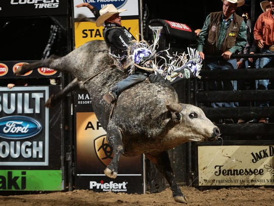 Guytin Tsosie grits out an 86-point ride on Bull Arrow at Sunday's Professional Bulls Riders Des Moines Invitational at Wells Fargo Arena.