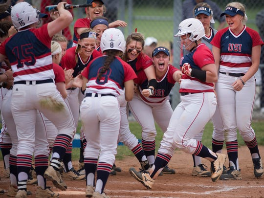 The Southern Indiana Screaming Eagles celebrate Haley Hodges' third inning home run as she crosses the plate to tie the game against Saginaw Valley State in the NCAA II Midwest Region #2 Tournament at USI Softball Field Friday afternoon.