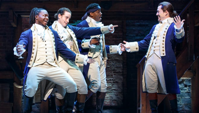 """The Chicago production of """"Hamilton,"""" starring (from left) Chris De'Sean Lee, Jose Ramos, Wallace Smith and Miguel Cervantes."""