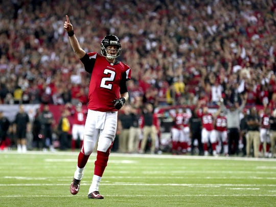 Quarterback Matt Ryan of the Atlanta Falcons reacts after a touchdown in the fourth quarter against the Green Bay Packers in the NFC Championship Game at the Georgia Dome on Jan.  22, 2017 in Atlanta.