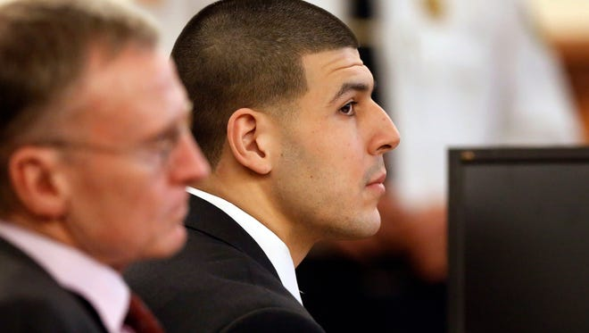 Aaron Hernandez, right, listens during his murder trial on Jan. 29, 2015.