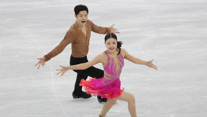 American ice dancers Maia and Alex Shibutani complete their short program during the team figure skating event.