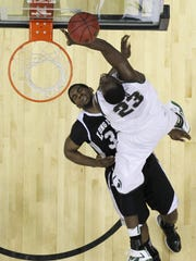 Draymond Green of the Michigan State Spartans puts