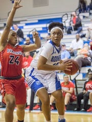 Janelle Jones (10) drives to the basket against Aaliyah Davenport (24) during the Region 1-7A quarterfinal girls basketball game between Washington and  Fort Walton Beach at Booker T. Washington High School in Pensacola on Thursday, February 15, 2018.