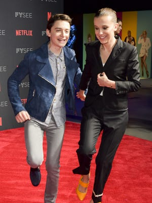 "Millie Bobby Brown (right) and Noah Schnapp arrive at the #NETFLIXFYSEE event for ""Stranger Things"" on May 19 in Los Angeles."
