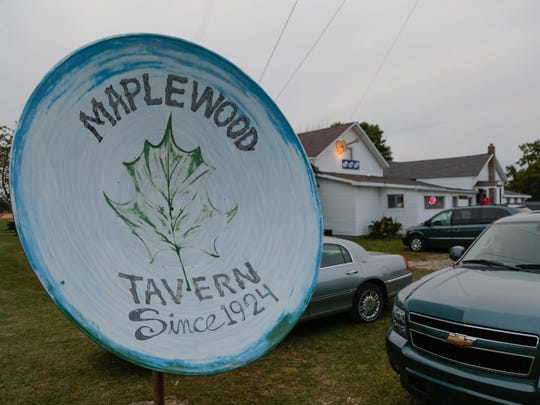 A satellite dish painted with the name of the Maplewood
