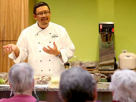 Statesman Journal Food, Beer and Wine Reporter Victor Panichkul leads a cooking class for easy meals under $5 at Natural Grocers in Salem on Friday, Oct. 16, 2015.