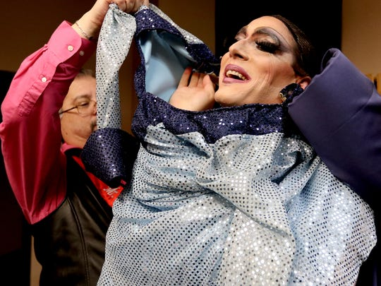 Robert Dickerson, left, assists 'Tonia Ward (Statesman Journal reporter Tom Mayhall Rastrelli) with a costume change during a drag show and fundraiser at the Southside Speakeasy on Jan. 10. At this point, Mayhall Rastrelli was stuck in the gown unable to move his arms.