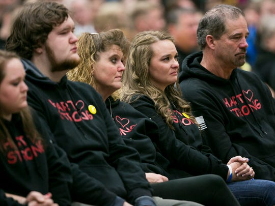Ty Hart's family, including his wife of seven months, Hanna, second from right, listen to friends speak about Ty's life at a memorial for the fallen Marine at Stayton High School on Saturday, Jan. 30, 2016. Lance Cpl. Hart was one of the 12 Marines who died Jan. 14 when two military helicopters collided during training exercises in Hawaii.