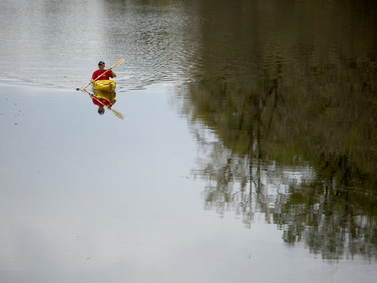 A man kayaks at Minto-Brown Island Park in Salem on Sunday, April 16, 2017.